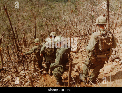 Troops of the C Co, 1st Battalion, 50th Mechanized, 1st Air Cavalry Division, move down the hillside - Stock Photo