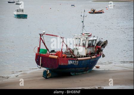 Boats at rest in the estuary. - Stock Photo
