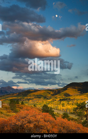 Full moon over autumn colors and the Sneffels Range, San Juan Mountains, Colorado. - Stock Photo