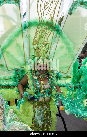 Mature woman in carnival costume. Notting Hill Carnival, Notting Hill. London. England. UK. - Stock Photo