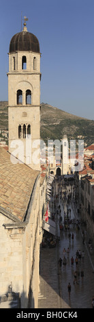 Tower of Franciscan Church Placa Stradun  Dubrovnik Croatia vertical panorama panoramic format - Stock Photo