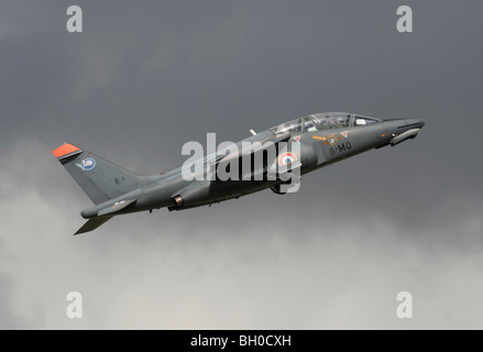 Military pilot training. French Air Force Alpha Jet two-seat trainer plane flying on takeoff. Side view. - Stock Photo
