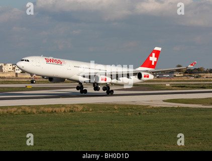Swiss International Air Lines Airbus A340-300 on takeoff - Stock Photo