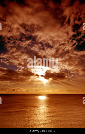 Sunset Altocumulus stratiformis Clouds over English Channel UK - Stock Photo