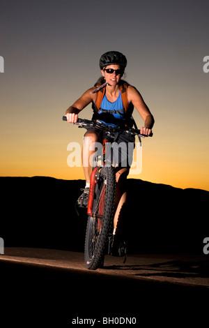 Mountain biking the famous Slickrock Trail, Moab, Utah. (model released) - Stock Photo