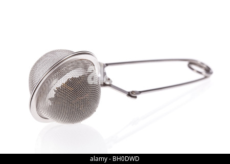 Tea infuser with Green Tea leaves isolated on a white background - Stock Photo