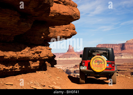 A jeep on the White Rim Trail, Island in the Sky District, Canyonlands National Park, near Moab, Utah. - Stock Photo