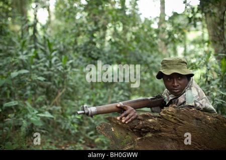 Rangers patrol the Kakamega Forest Reserve in Western Kenya. - Stock Photo
