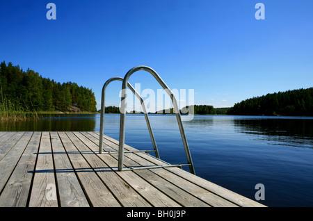 Private jetty in a bay under blue sky, Saimaa Lake District, Finland, Europe - Stock Photo
