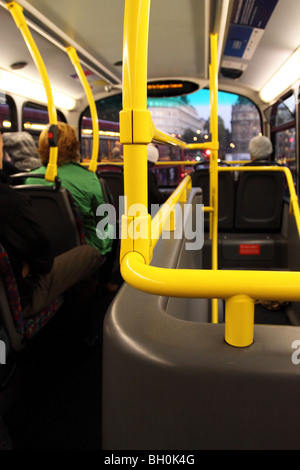 London bus interior view of passengers seated on upper ...
