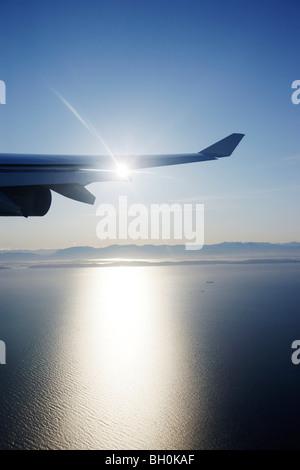 View through airplane window to Rocky Mountains, Oregon, USA - Stock Photo
