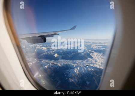 View through airplane window over Rocky Mountains, Oregon, USA - Stock Photo