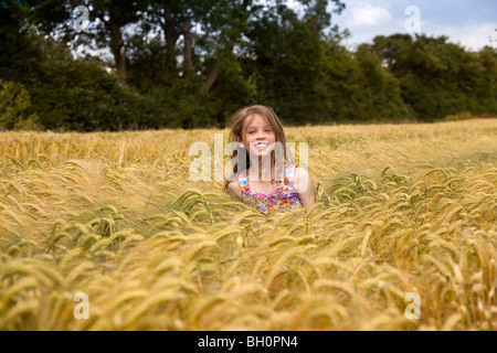 Close up of Girl in Wheat Field in Lincolnshire,England,GB - Stock Photo