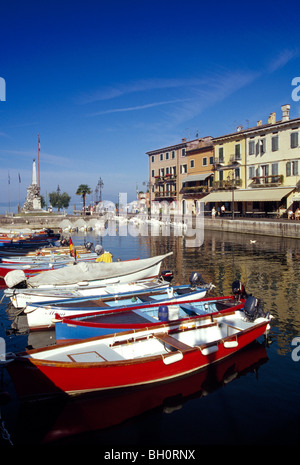 Fishing boats at harbour in the sunlight, Lazise, Lake Garda, Veneto, Italy, Europe - Stock Photo