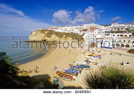 Fishing boats and people on the beach, Carvoeiro, Algarve, Portugal, Europe - Stock Photo
