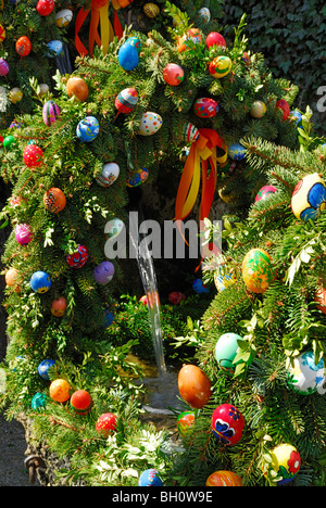 Easter decorated fountain, Goessweinstein, Upper Franconia, Bavaria, Germany - Stock Photo