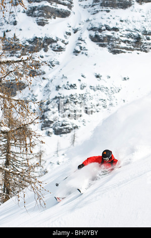 A skier going downhill in the powder snow, Krippenstein, Austria - Stock Photo