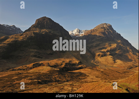 The Glencoe hills in early spring with snow on the highest tops, Glencoe, Argyll, Scottish Highlands, UK. - Stock Photo