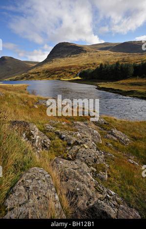 The River Lyon flowing beneath Creag Loaghain in Glen Lyon Perthshire, Scotland, UK. - Stock Photo