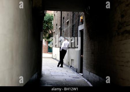 Office worker in London taking a cigarette break - Stock Photo