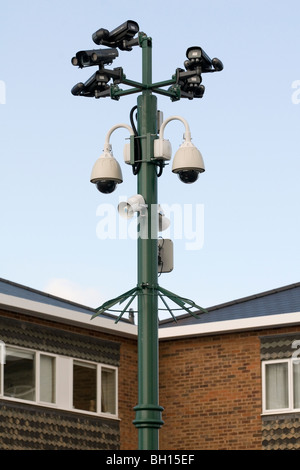A cluster of CCTV cameras and floodlights mounted on a post in a car park in Worcestershire England UK - Stock Photo
