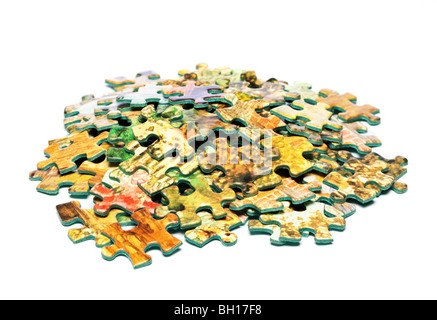 Pile of jigsaw pieces, cut out on white background - Stock Photo
