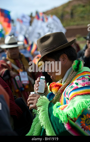 Pachamama ceremony, man drinking alcohol  on the day of Evo Morales second presidential assumption in Tiwanaco, - Stock Photo
