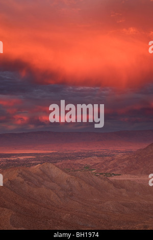 Sunset over Palm Desert and Rancho Mirage in the Coachella Valley, California. - Stock Photo