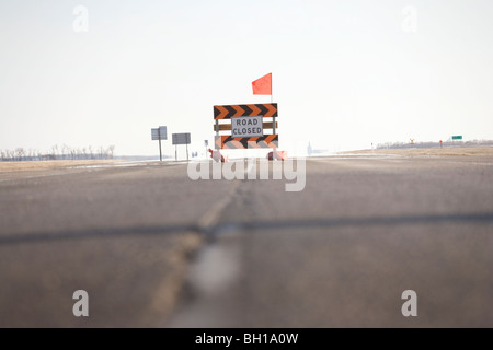 Road closed sign in middle of highway, due to Red River flooding, rural Manitoba, Canada - Stock Photo