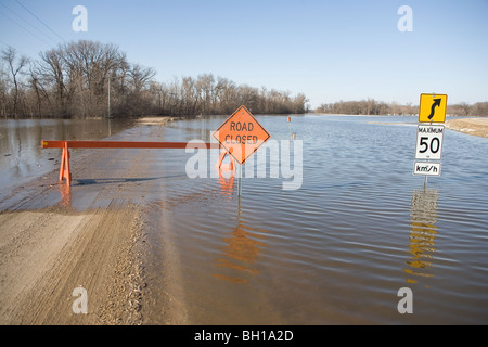 Road is closed due to Red River flooding in rural Manitoba, Canada - Stock Photo