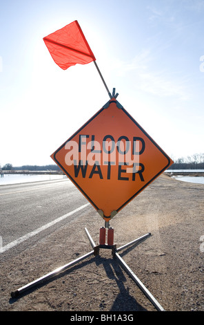 Floodwater warning sign beside highway, rural Manitoba, Canada - Stock Photo