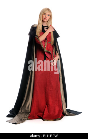 Beautiful woman dressed in Renaissance dress with cloak cape - Stock Photo
