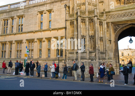 People queueing for bus stop in front of Christ Church in High street Oxford England UK Europe - Stock Photo