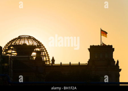 silhouette of German parliament, Reichstag dome at sunset, Berlin, Germany - Stock Photo