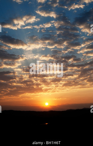 Golden indian sunrise and a cloudy sky. Andhra Pradesh, India - Stock Photo