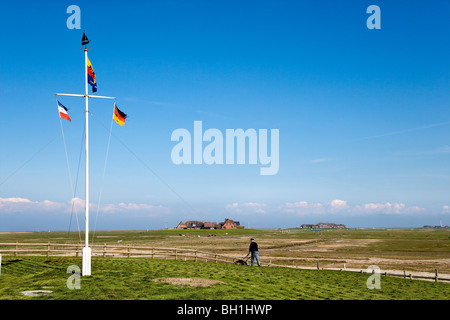Flagpole at Hooge hallig, North Frisian Islands, Schleswig-Holstein, Germany - Stock Photo