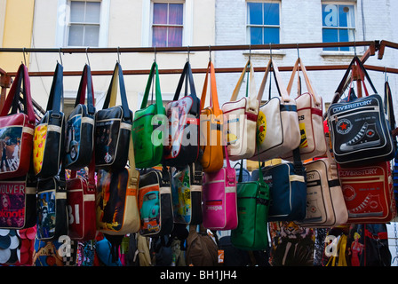 Bags for sale Portobello Road Notting Hill West London England UK - Stock Photo