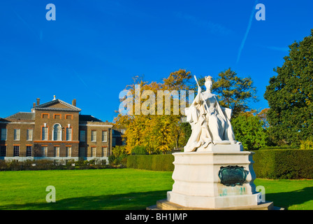 Statue of Queen Victoria in front of Kensington Palace in Kensington Gardens west London England UK - Stock Photo