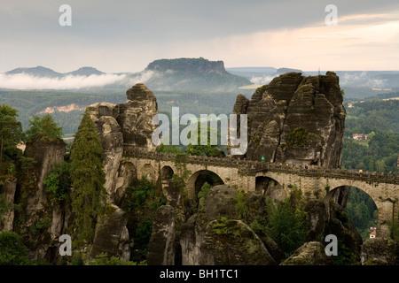 Bastei bridge with mount Lilienstein in background, Bastei, Elbe Sandstone Mountains, Saxon Switzerland, Saxony, - Stock Photo