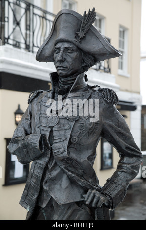 A life-size bronze statue of Nelson, sculpted by local artist Lesley Pover, outside the Trafalgar Tavern in Greenwich - Stock Photo