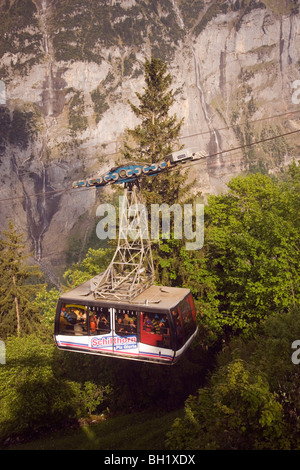 Fully occupied cabin of the Schilthornbahn on the way from Gimmelwald to Schilthorn, Gimmelwald near Muerren, Bernese - Stock Photo