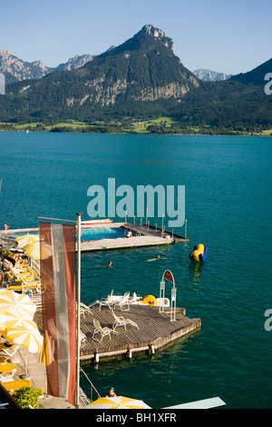 View over lake Wolfgangsee with Hotel Im Weissen Roessl am Wolfgangsee, St. Wolfgang, Upper Austria, Salzkammergut, - Stock Photo