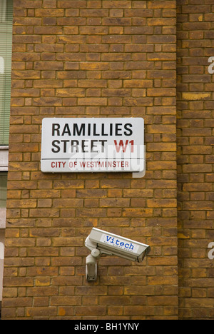 Street sign and CCTV camera Ramilles street city of Westminster central London England UK - Stock Photo