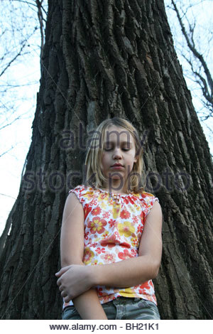 Sad Girl Leaning Against A Tree Stock Photo 79900195 Alamy