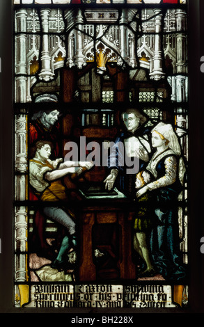 St Margaret's Church Westminster 19th century stained glass window showing William Caxton at his printing press. - Stock Photo