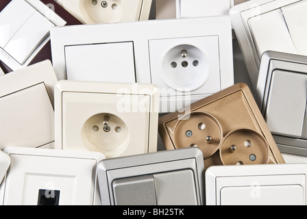 couple of electrical colorful switches and sockets - Stock Photo