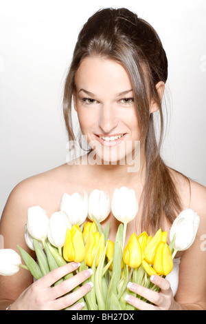 Woman with flowers - Stock Photo
