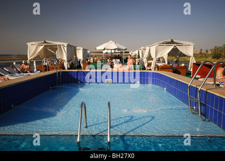 RIVER NILE, UPPER EGYPT. Swimming pool on a Nile cruise boat. - Stock Photo
