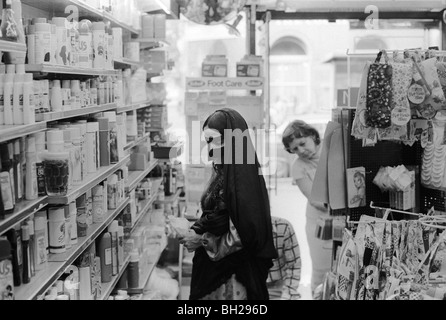 Middle eastern woman shopping in chemist shop Earls Court London 1977 Health Care tourist 1970s England  HOMER SYKES - Stock Photo