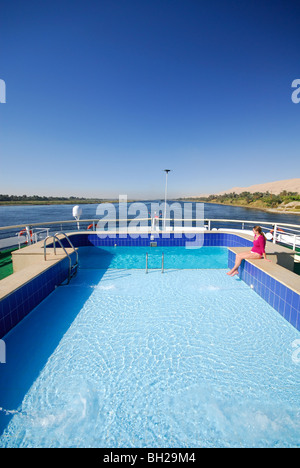 RIVER NILE, UPPER EGYPT. Swimming pool on a Nile cruise boat sailing between Luxor and Aswan. - Stock Photo